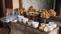 Breakfast brunch buffet at a luxury safari lodge (hotel) in South Africa with fresh fruits, cereals, cheese, croissants, rolls and cookies.