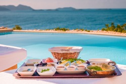 breakfast by the pool looking out over the Kas rivera Turkey