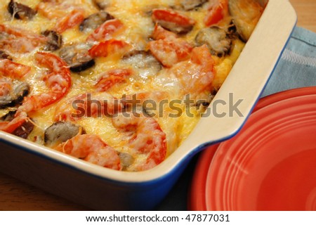 ... with eggs, sausage, tomatoes, potatoes, onion and cheese - stock photo