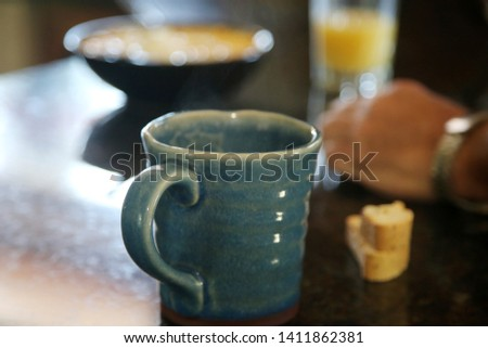Breakfast cereal. Breakfast with Cereal, Orange Juice, Milk, Vitamins, Raisins, Banana, and Coffee.  #1411862381