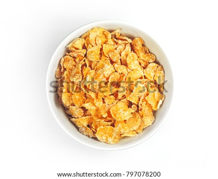 Breakfast cereals or cornflakes in awhile bowl. Breakfast bowl, isolated on white background. High angle view.