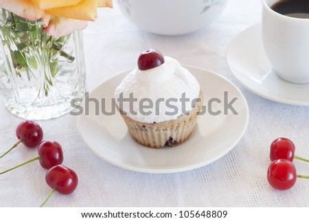 Breakfast: cherry muffins with coffee