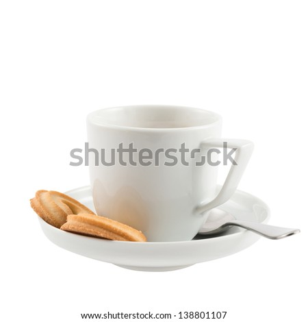 Breakfast composition: ceramic white cup, plate, spoon and butter cookies isolated over white background