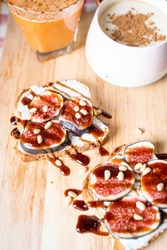 Breakfast Concepts, Toasts with Cream Cheese, Figs, Pine Nuts and Raspberry Balsamic Sauce, Cup of Cappuccino and Carrot-Apple Juice