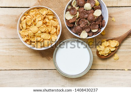 Breakfast Cornflakes and various cereals in bowl and milk cup on wooden background for cereal healthy food in the morning #1408430237
