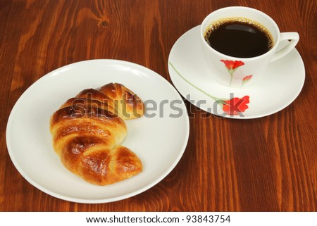 Breakfast - croissant and coffee