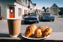 Breakfast croissants and coffee at the morning in small American town