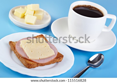 Breakfast. Cup of coffee and toast with ham and cheese