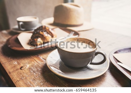 Breakfast, cups of coffee and fresh croissant on a table in a cafe.  Travel, vacations, local food, lifestyle, summer fun, enjoy life concept Foto d'archivio ©