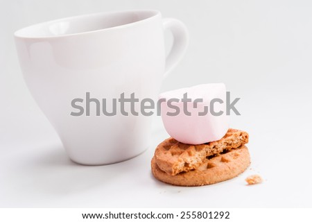 Breakfast food:  ceramic white cup with chocolate and butter cookies isolated over white background
