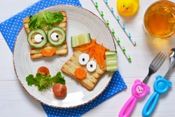 Breakfast for a child - children's funny toasts with a grilled and carrot.