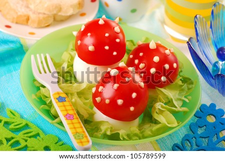 breakfast for child with fly agaric mushrooms made from boiled egg ,tomato and mayonnaise