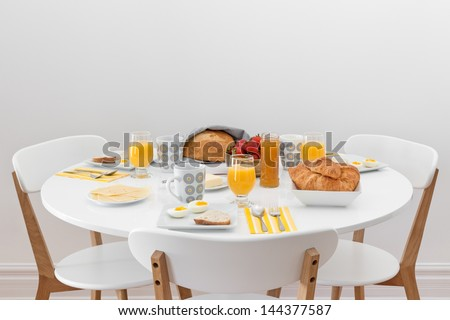 Breakfast for three. Simple tasty morning meal on a white table.