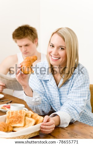 Breakfast happy couple enjoy romantic morning eat croissant