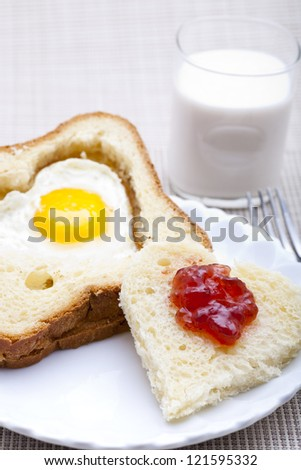 Breakfast - heart shaped bread and egg.