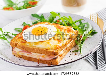 Breakfast.  Hot sandwich. Croque madame sandwich and a cup of latte macchiato coffee on the table. French cuisine. Copy space Photo stock ©