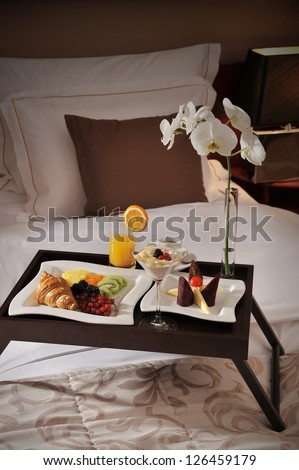Breakfast in bed at a luxury hotel room