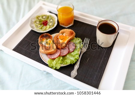 Stock Photo breakfast in bed on a tray, with coffee and juice
