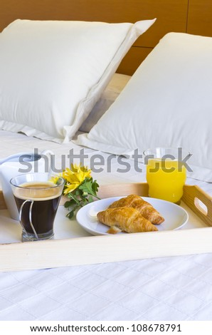 Breakfast in bed with coffee and cookies and juice