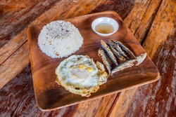 Breakfast in Philippines - rice, fries fish and egg