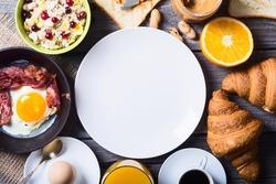 Breakfast including coffee, fried egg , croissant, orange juice , muesli and bread .
