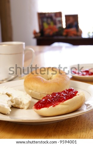 stock photo : Breakfast of plain bagels with coffee, cream cheese, and strawberry preserves