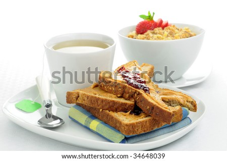 Breakfast of toast and cereal served with tea.