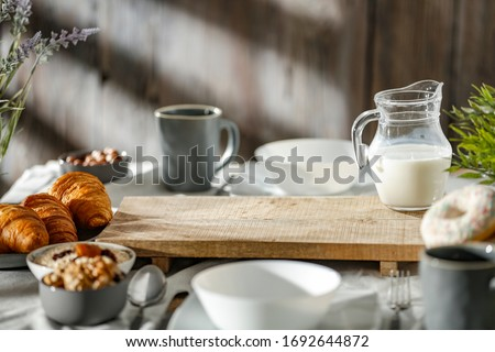 Breakfast on a wooden table in the light of the morning sun on a beautiful holiday day Foto stock ©
