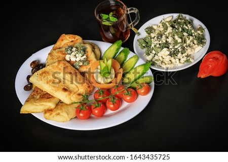 Breakfast or dinner meals with vegetables, pastries and good grills
