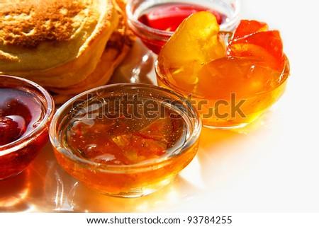 Breakfast - pancakes and jam. White background.