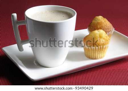 Breakfast pastries and a cup of milk