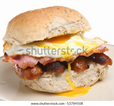 Breakfast roll with bacon, sausages and fried egg.