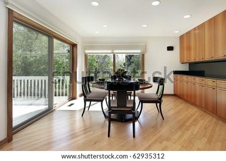 Breakfast room in luxury home with door to deck