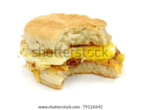 Breakfast sandwich biscuit with bacon egg and cheese that has been bitten once.