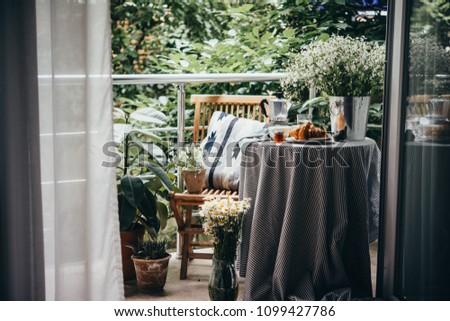 Breakfast served on a beautiful terrace or balcony #1099427786