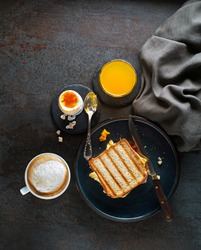 Breakfast served with coffee, juice, toast sandwich and boiled egg. Delicious healthy breakfast.