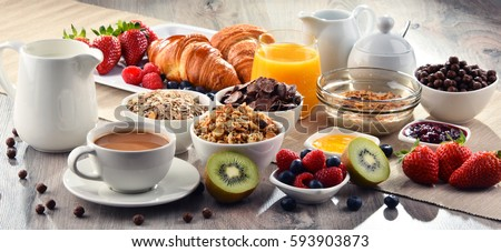 Breakfast served with coffee, orange juice, croissants, cereals and fruits. Balanced diet. - Shutterstock ID 593903873