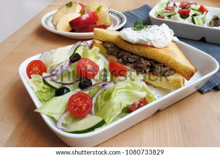 breakfast table: mushroom sandwich with poached egg, salad and apple #1080733829