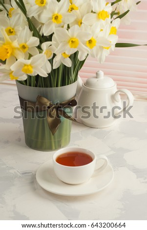 Breakfast Table Setting With Tea Teapot And Spring Flowers Background Vertical