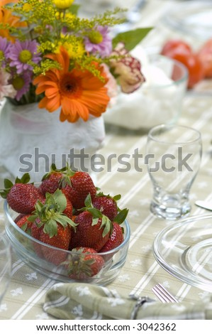 Breakfast table with fruit and flowers