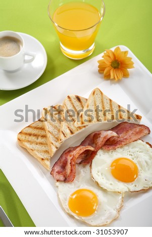 Breakfast - toasts, eggs, bacon - stock photo