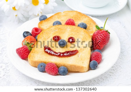 Breakfast with a smiling toast and fresh berries, closeup