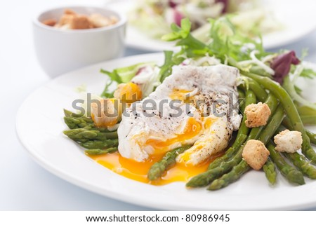 Breakfast with asparagus,eggs and tomato