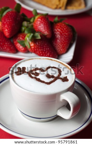 Breakfast with cappuccino with a broken heart pattern - stock photo