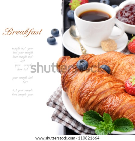 Breakfast with coffee and fresh croissants