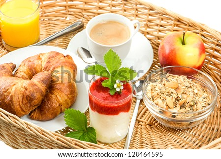 breakfast with coffee croissants orange juice and fresh strawberry yogurt