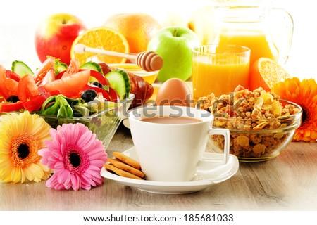 Breakfast with coffee, juice, croissant, salad, muesli and egg. Swedish buffet