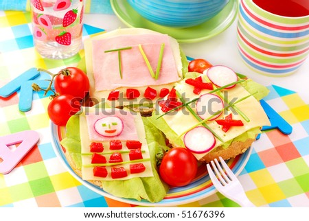 breakfast with cottage cheese for child with funny shape sandwich