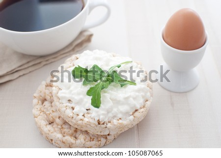 Breakfast with cottage cheese, rice cracker, egg and coffee