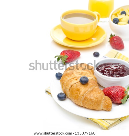 Breakfast with croissant, jam, fresh berries and coffee with milk isolated on white background